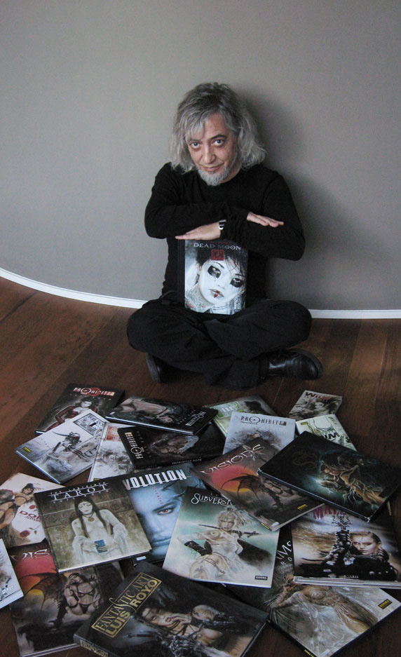 Luis Royo, surrounded by books studio photo